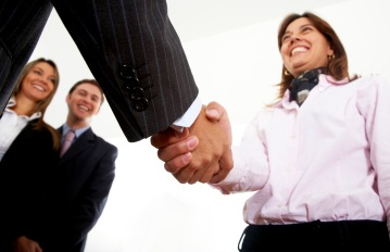 business handshake in an office to seal a partnership